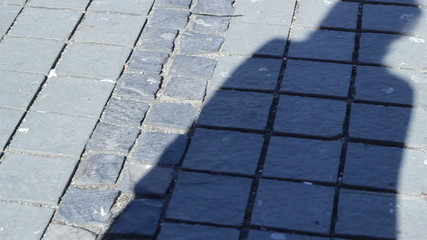Shaddow Walking on Pavement