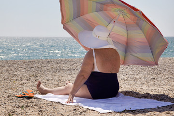 Woman overweight on the beach