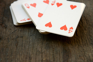 Deck of cards on wooden background