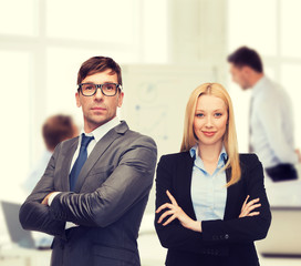 businessman and businesswoman in the front of team