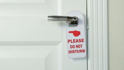 Do Not Disturb hanger on the door of hotel room
