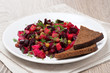 russian beetroot  salad with bread - vinaigrette on a plate