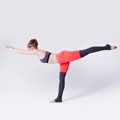 Woman balancing while, yoga poses
