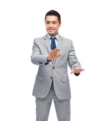 happy businessman in suit touching something