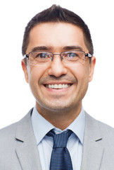 happy smiling businessman in eyeglasses and suit