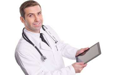 Top view of medical doctor using tablet pc with empty screen / I