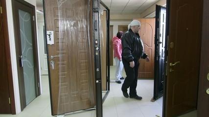 Customers looking for new door in the doors store showroom