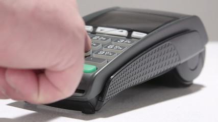 Hand swiping debit card through credit card terminal