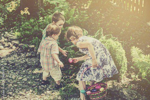 canvas print picture Children on an Easter Egg Hunt - Retro Filtered