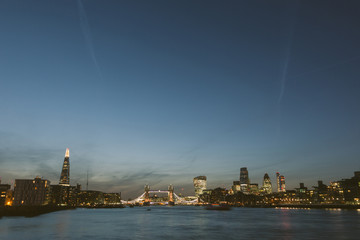 London skyline at dusk with River Thames on foreground