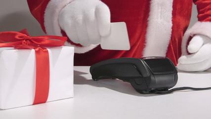 Santa Claus using credit card processing terminal