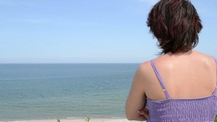 Woman Is Looking Towards Sea Horizon