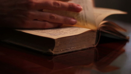 Woman Searches an Old Book