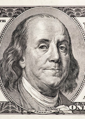 Close-up portrait of Benjamin Franklin in front of the one hundr