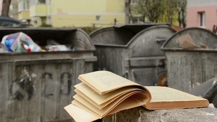 Yellowed Book and Dumpster