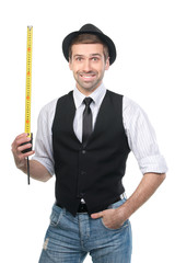 Handsome man in black hat with measure tape. Isolated over white