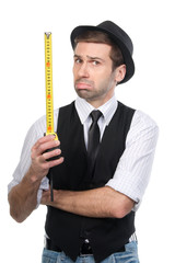Sad handsome man in black hat with measure tape data. Isolated o