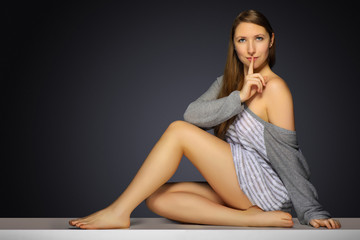 Woman keeping finger on her lips