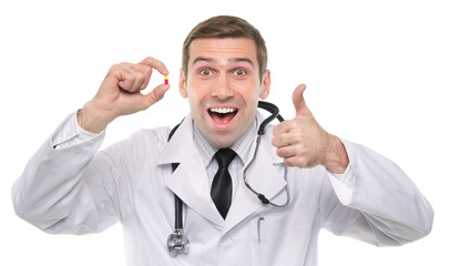 Happy medical doctor with yellow-red pill and thumbs up gesture/