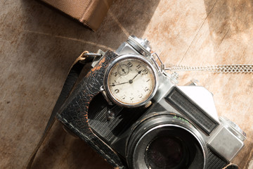 Vintage watch and camera.