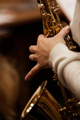 Hand girl playing the saxophone