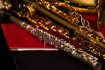 Flute and saxophone closeup in dark colors
