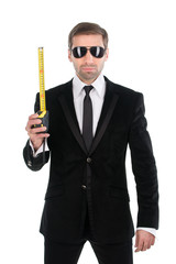 Stylish businessman in sunglasses with tape measure. Isolated on
