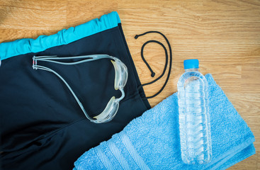 glasses and Swimming trunks , water Bottles , towel
