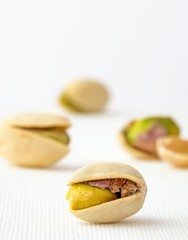 Close up image of an open pistachio nut and shell