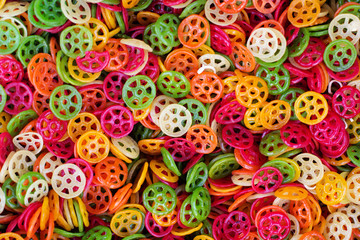 Background of colorful pasta as texture, close-up.