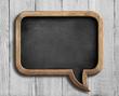 old chalkboard in shape of speech bubble on white wood - 79693630