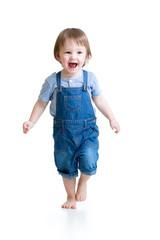 Happy little boy running