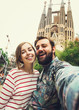 Happy couple takes selfie while travel in Barcelona, Spain - 79695066