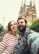 Leinwandbild Motiv Happy couple takes selfie while travel in Barcelona, Spain