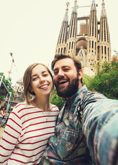 Happy couple takes selfie while travel in Barcelona, Spain
