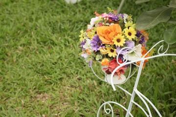 Flowers in car pot in the garden
