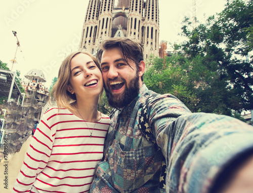 Leinwanddruck Bild Happy couple takes selfie while travel in Barcelona, Spain