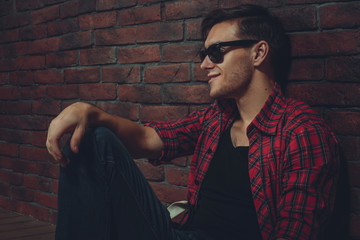 portrait hipster smilling man with glasses casual clothes