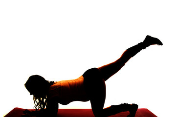 silhouette of a pregnant woman exercise on knee leg up