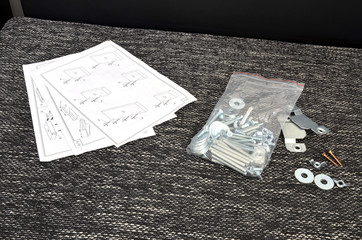 Assembling parts of sofa with instruction