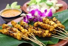 "Постер, картина, фотообои ""chicken satay with peanut sauce, indonesian skewer cuisine"""