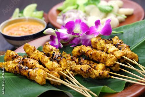 Leinwandbild Motiv chicken satay with peanut sauce, indonesian skewer cuisine