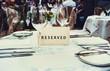 Leinwandbild Motiv Reserved sign on a table in restaurant