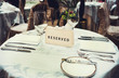 Reserved sign on a table in restaurant - 79696850