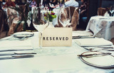 Reserved sign on a table in restaurant - 79696844
