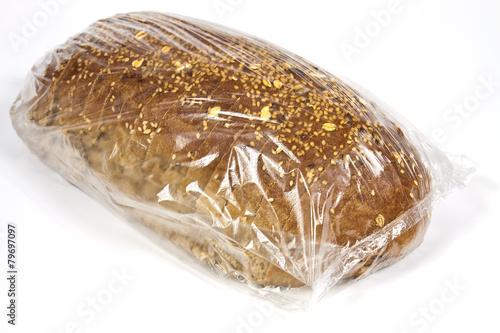 Packaged in plastic bread - 79697097