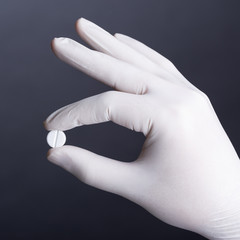 Hand with pill