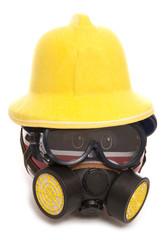 piggy bank wearing gas mask and fireman hat