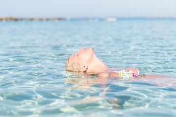 Attractive woman enjoying tropical sea