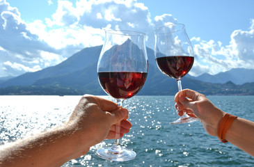 Two wineglasses in the hands